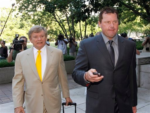 Former Major League Baseball pitcher Roger Clemens, right, and his attorney Rusty Hardin, arrive at federal court in Washington July 13, 2011, for his perjury trial. (AP Photo/Alex Brandon)