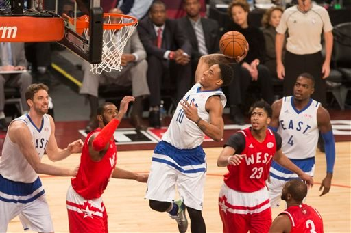 Eastern Conference's DeMar DeRozan, of the Toronto Raptors (10) scores on the Western Conference's defense during the first half of the NBA all-star basketball game, Sunday, Feb. 14, 2016 in Toronto.