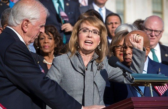 Former Rep. Gabby Giffords of Arizona who survived an assassination attempt in 2011, flanked by Rep. Mike Thompson, D-Calif., left, and Rep. John Lewis, D-Ga., right, joins House Democrats in a call for action on gun safety.