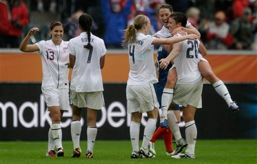 US players celebrate their 3-1 winning of the semifinal match between France and the United States at the Women's Soccer World Cup in Moenchengladbach, Germany, Wednesday, July 13, 2011.