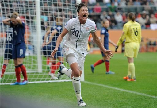 United States' Abby Wambach celebrates scoring her side's 2nd goal during the semifinal match between France and the United States at the Women's Soccer World Cup in Moenchengladbach, Germany, Wednesday, July 13, 2011.