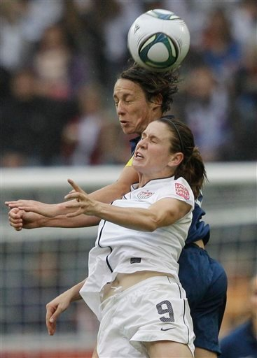 United States' Heather O Reilly and France's Sandrine Soubeyrand challenge for the ball during the semifinal match between France and the United States at the Women's Soccer World Cup in Moenchengladbach, Germany, Wednesday, July 13, 2011.