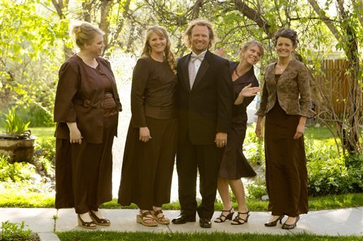 "FILE - In this undated file photo provided by TLC, Kody Brown, center, poses with his wives, from left, Janelle, Christine, Meri, and Robyn in a promotional photo for TLC's reality TV show, ""Sister Wives."""