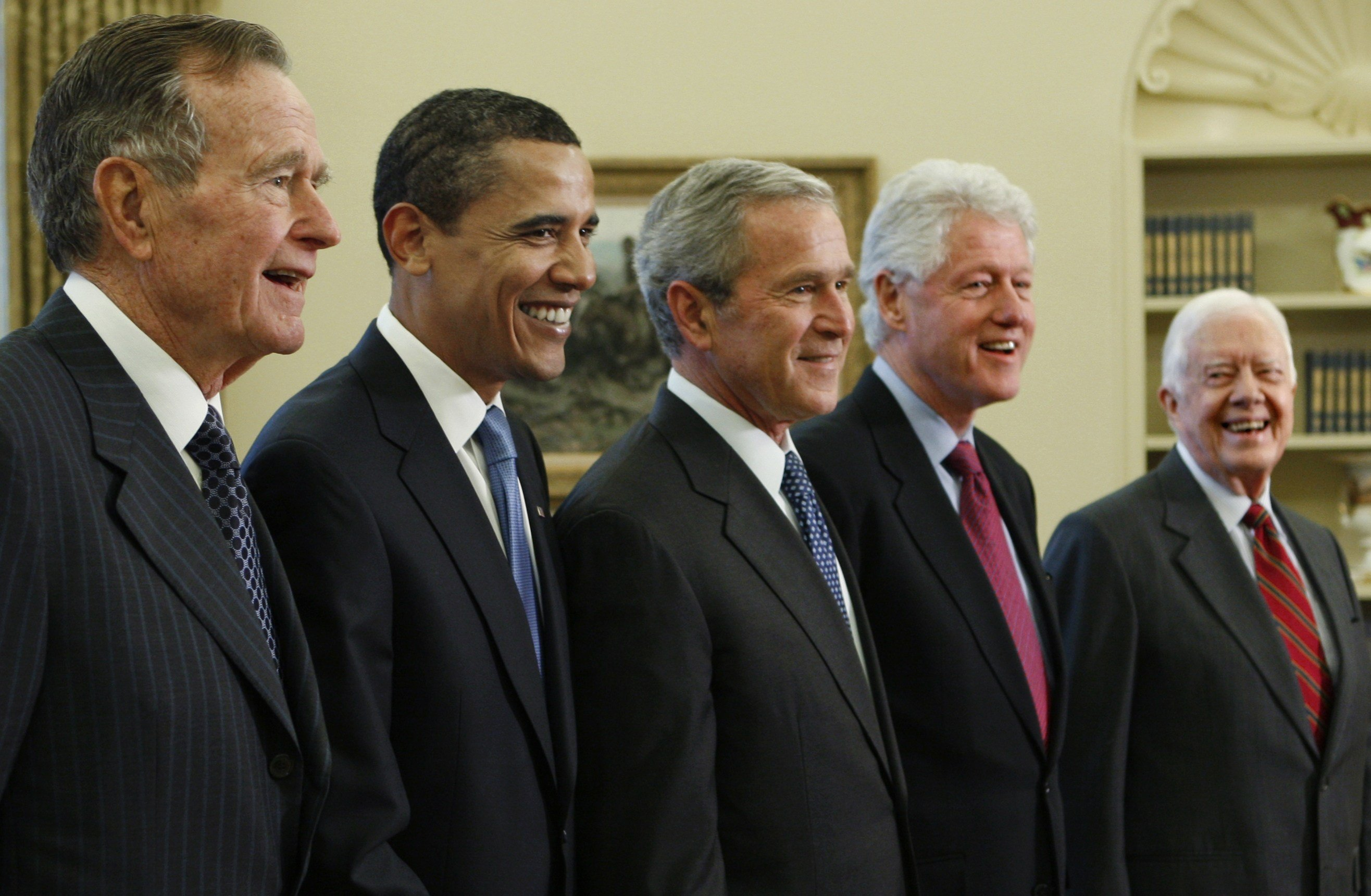 President George W. Bush, center, poses with President-elect Barack Obama, and former presidents, from left, George H.W. Bush, left, Bill Clinton and Jimmy Carter, right, Wednesday, Jan. 7, 2009, in the Oval Office of the White House in Washington. (AP Ph