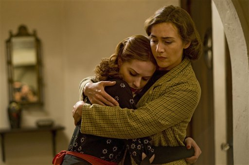 "In this publicity image released by HBO, Evan Rachel Wood, left, and Kate Winslet are shown in a scene from the HBO mini-series, ""Mildred Pierce."""