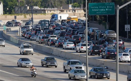 Traffic on Interstate 405 is seen from the Sherman Oaks Galleria mall parking lot Wednesday, July 13, 2011, in Los Angeles. (AP Photo/Damian Dovarganes)