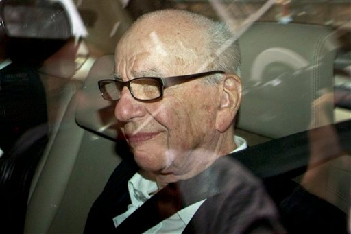 News Corporation chairman Rupert Murdoch arrives at his residence in central London, Wednesday, July 13, 2011. (AP Photo/Sang Tan)