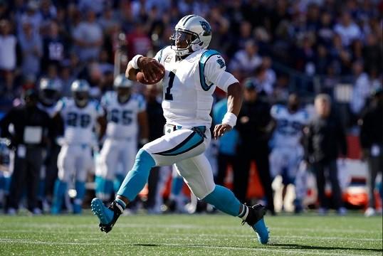 Carolina Panthers quarterback Cam Newton runs during the second half of an NFL football game.