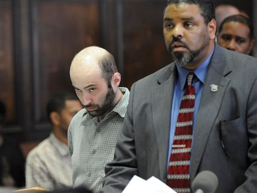 Defense attorney Pierre Bazile speaks on behalf of Levi Aron, left, at his arraignment before Judge William Miller in Brooklyn criminal court, Thursday, July 14, 2011, in New York.