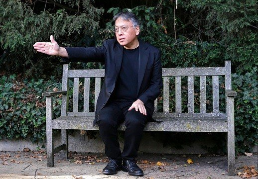 British novelist Kazuo Ishiguro gestures during a press conference at his home in London.