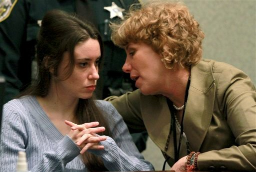 Casey Anthony, left, talks with her attorney, Dorothy Clay Sims, during a sentencing hearing in Orlando, Fla. on Thursday, July 7, 2011.