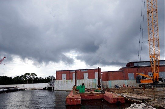 Clouds gather over a pumping station at Marconi Drive and lake Pontchartrain in New Orleans.