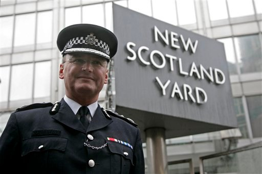A Wednesday, Jan. 28, 2009 photo from files showing Metropolitan Police Commissioner, Sir Paul Stephenson, outside New Scotland Yard in London. London's police chief announced he had quit Sunday, July 17, 2011, over his links to a former News of the World