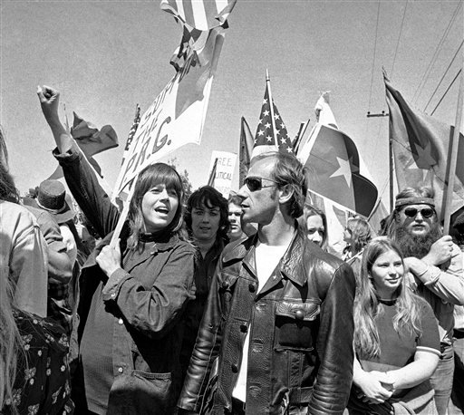 In this April 2, 1973 file photo, actress Jane Fonda holds her arm up in the air as she joins a group of anti-war demonstrators on a march toward the Western White House to protest the visit of South Vietnam's President Nguyen Van Thieu in San Clemente
