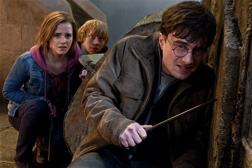 """In this film publicity image released by Warner Bros. Pictures, from left, Emma Watson, Rupert Grint and Daniel Radcliffe are shown in a scene from """"Harry Potter and the Deathly Hallows: Part 2."""" (AP Photo/Warner Bros. Pictures, Jaap Buitendijk)"""
