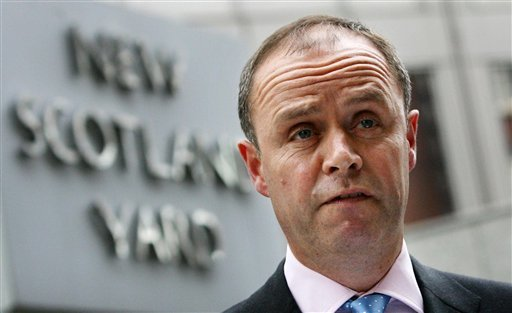 London's Metropolitan Police Assistant Commissioner John Yates stands outside the force's headquarters at New Scotland Yard in London, in this July 9 2009 file photo. Yates resigned Monday July 18, 2011, amid the firestorm surrounding the phone hacking s