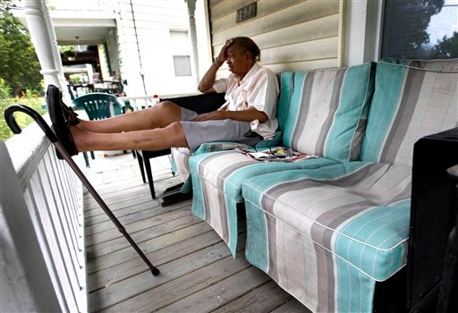 Walter Gatewood, 87, sits on his front porch trying to beat the heat in Flint, Mich., Monday, July 18, 2011. With a heat index well over 100 in most places, a heat wave smothered the Midwest Monday.