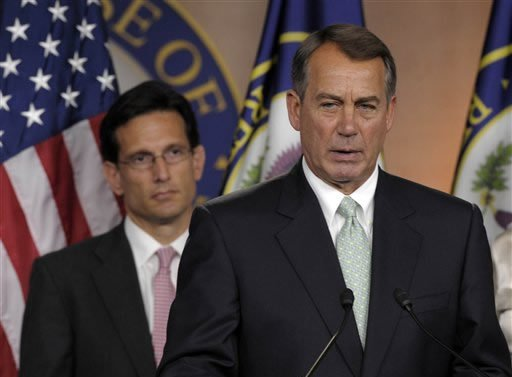 House Speaker John Boehner of Ohio, right, speaks during a news conference with House Majority Leader Eric Cantor, R-Va., left, on Capitol Hill in Washington, Friday, July 15, 2011.