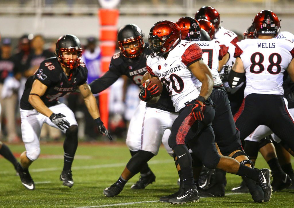 San Diego State's Rashaad Penny (20) runs the ball against UNLV during an NCAA college football game in Las Vegas on Saturday, Oct. 7, 2017. (Chase Stevens/Las Vegas Review-Journal via AP)