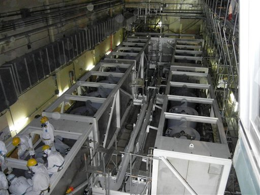 In this June 1, 2011 file photo released by Tokyo Electric Power Co. (TEPCO), workers inspect equipments inside the cesium absorption tower, part of the radioactive water processing facilities at Fukushima Dai-ichi nuclear power plant in Okuma, Fukushima