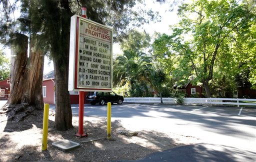 A welcome sign at the entrance to the Creative Frontiers preschool and elementary school is seen Tuesday, July 19, 2011, after California officials closed the private school amid accusations of child molestation, in Citrus Heights, Calif.