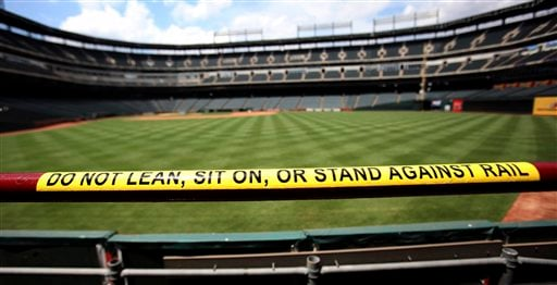 A new warning sticker on a railing is shown in the stands at Texas Rangers ballpark before a news conference announcing new safety measures at the ballpark in Arlington, Texas, Tuesday, July 19, 2011.