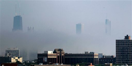 Cool air off Lake Michigan filters through as fog in downtown Chicago as temperatures climb into the 90's coupled with high humidity producing excessive heat warnings though out the Midwest, Tuesday, July 19, 2011. (AP Photo/Charles Rex Arbogast)