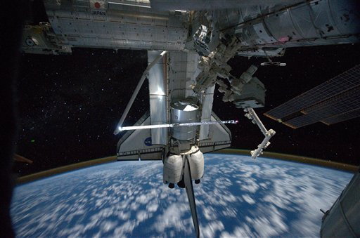 This image provided by NASA shows a view of the space shuttle Atlantis while still docked with the International Space Station taken by crew member Mike Fossum aboard the station July 18, 2011. (AP Photo/NASA - Mike Fossum)