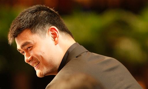 NBA star Yao Ming smiles after he announced his retirement during a press conference in Shanghai, China, Wednesday, July 20, 2011. (AP Photo/Eugene Hoshiko)