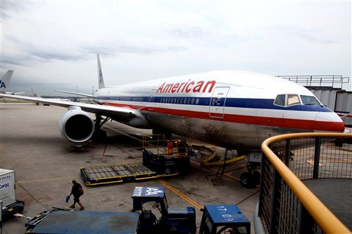 An American Airlines plane is parked at the terminal at O'hare International airport in Chicago July 20, 2011. American Airlines is buying at least 460 new planes in what it calls the biggest airline order in history. (AP Photo/Robert Ray)