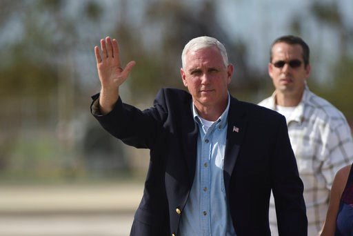 U.S. Vice President Mike Pence waves upon his arrival at the Muniz National Guard Air Base, in San Juan, Puerto Rico, Friday, Oct. 6, 2017. (AP Photo/Carlos Giusti)
