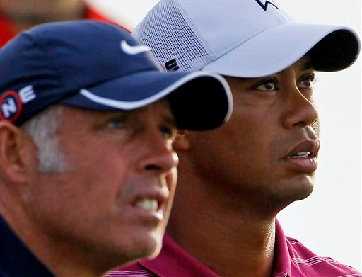 This Aug. 10, 2010, file photo shows Tiger Woods and caddie Steve Williams on the third tee during a practice round for the PGA Championship golf tournament, at Whistling Straits in Haven, Wis.