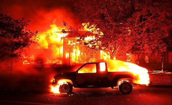 Coffey Park homes burn early Monday Oct. 9, 2017 in Santa Rosa, Calif.