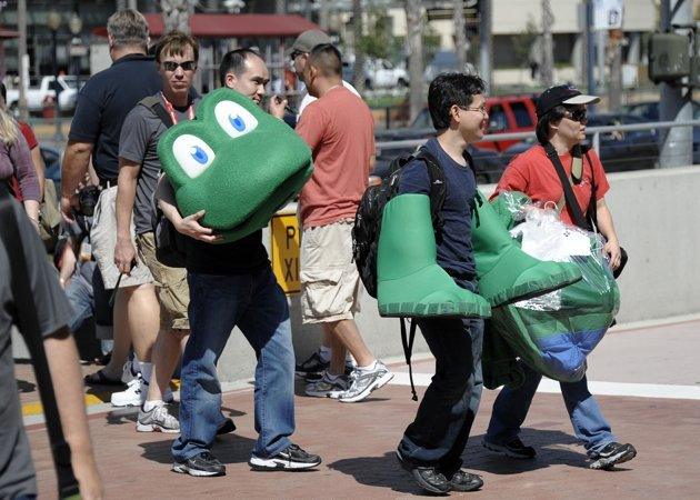 "Exhibitors bring in pieces of a ""Frogger"" display to set-up before Preview Night at the Comic-Con 2011 convention, Wednesday, July 20, 2011 in San Diego. (AP Photo/Denis Poroy)"