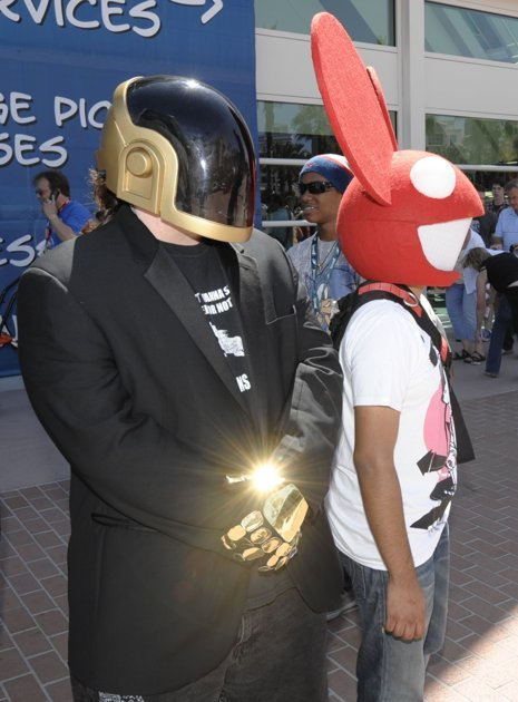 Costumed characters wait in front of the San Diego Convention center during Preview Night at the Comic-Con 2011 convention Wednesday, July 20, 2011 in San Diego. (AP Photo/Denis Poroy)