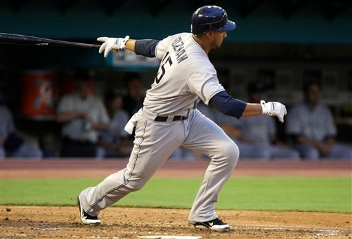 San Diego Padres' Jesus Guzman follows through on an RBI double to score three runs during the second inning of a baseball game against the Florida Marlins, Wednesday, July 20, 2011, in Miami. (AP Photo/Lynne Sladky)