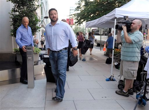 Jeff Saturday, of the Indianapolis Colts, arrives at the NFL Players Association offices in Washington, Wednesday, July 20, 2011. (AP Photo/Susan Walsh)