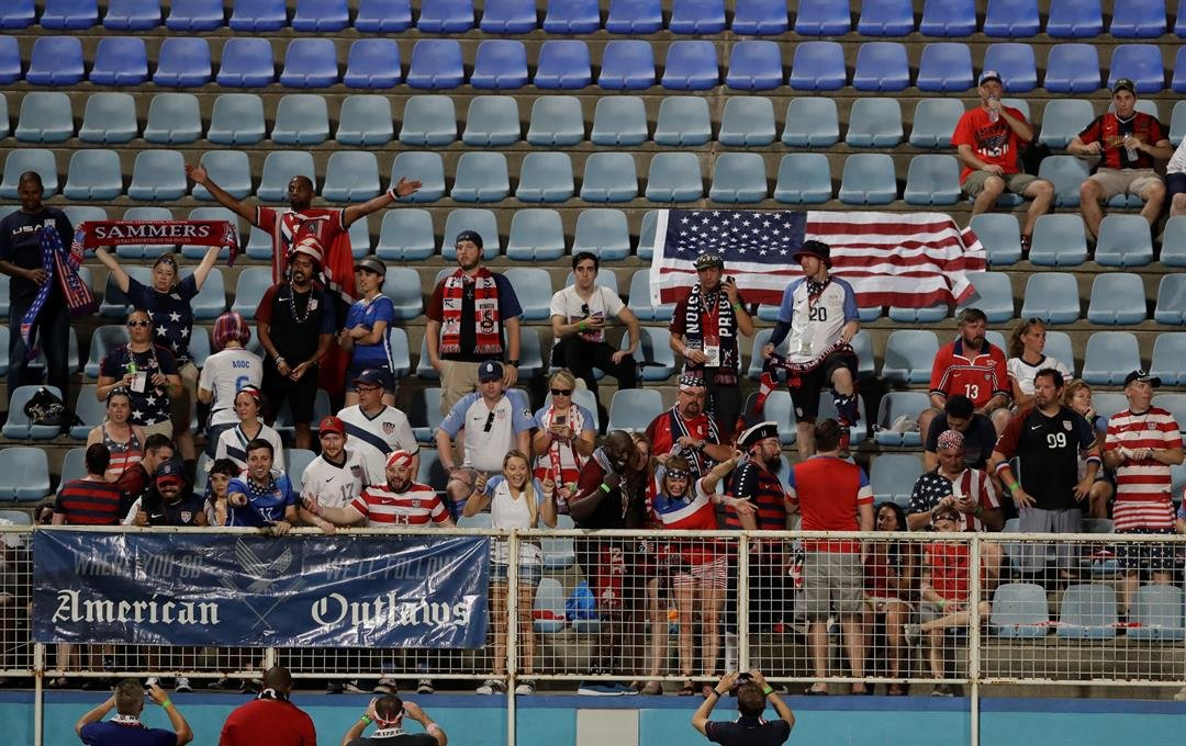 U.S. fans cheer during a 2018 World Cup qualifying soccer match against Trinidad and Tobago  in Couva, Trinidad, Tuesday, Oct. 10, 2017. (AP Photo/Rebecca Blackwell)