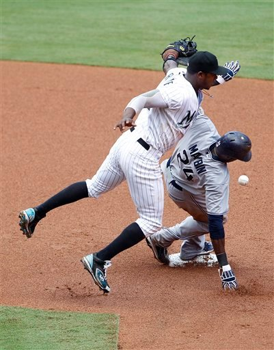 San Diego Padres' Cameron Maybin, right, is safe stealing second in front of Florida Marlins shortstop Hanley Ramirez during the third inning of a baseball game, Thursday, July 21, 2011, in Miami.