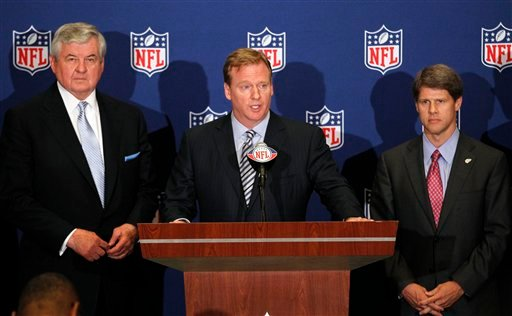 NFL football commissioner Roger Goodell, center, announces that NFL owners have agreed to a tentative agreement that would end the lockout pending the players approval in College Park, Ga., on Thursday, July 21, 2011.