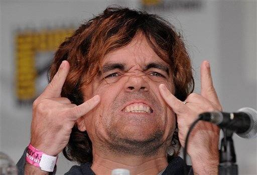 "Actor Peter Dinklage gestures to the crowd as he arrives for a panel for the Emmy nominated HBO show ""The Game of Thrones"" at the Comic-Con International 2011 convention held in San Diego Thursday, July 21, 2011."