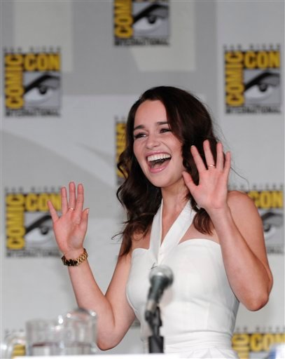 "Actress Emilia Clarke waves to the crowd as she arrives for a panel for the Emmy nominated HBO show ""The Game of Thrones"" at the Comic-Con International 2011 convention held in San Diego Thursday, July 21, 2011."