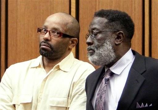 Defendant Anthony Sowell, left, stands with attorney Rufus Sims during his murder trial in Cleveland Friday, July 15, 2011. Sowell, 51, is charged with killing 11 women and hiding their remains in and around his home.
