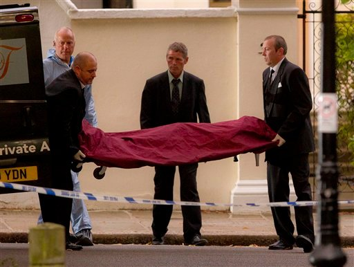A body, believed to be that of singer Amy Winehouse, is removed from her home following her death, in north London, Saturday, July 23, 2011. Amy Winehouse, the soul-jazz diva whose self-destructive habits overshadowed a distinctive musical talent,