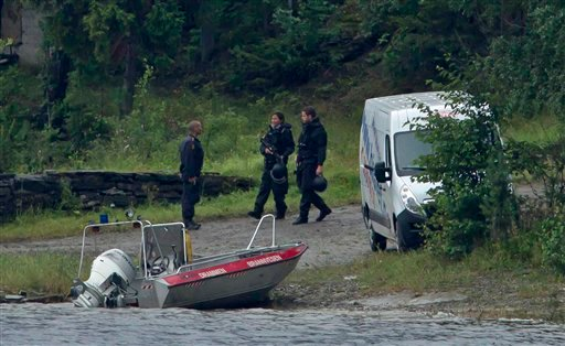 Armed police officers are seen on the island of Utoya, Norway Saturday, July 23, 2011. The 32-year-old man suspected in bomb and shooting attacks that killed at least 91 people in Norway bought six tons of fertilizer before the massacres