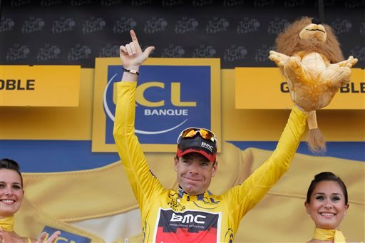 New overall leader Cadel Evans of Australia celebrates on the podium of the 20th stage of the Tour de France cycling race, an individual time trial over 42.5 kilometers (26.4 miles) starting and finishing in Grenoble, Alps region, France, Saturday July 23