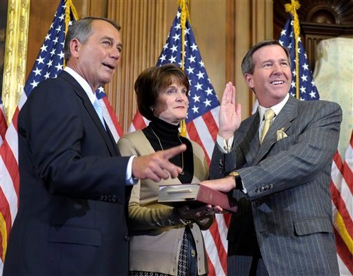 In this Jan. 5, 2011, file photo, House Speaker John Boehner of Ohio reenacts the House swearing in of Rep. John Campbell, R-Calif., on Capitol Hill in Washington. (AP)