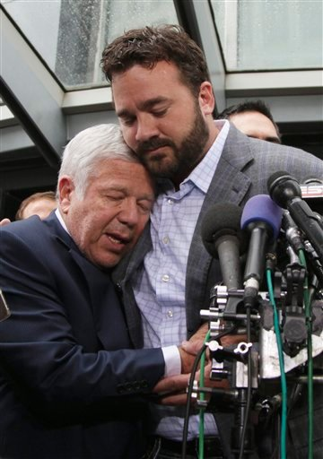 New England Patriots football owner Robert Kraft owner, left, is hugged by Jeff Saturday of the Indianapolis Colt during a news conference at the NFL Players Association in Washington, Monday, July 25, 2011.