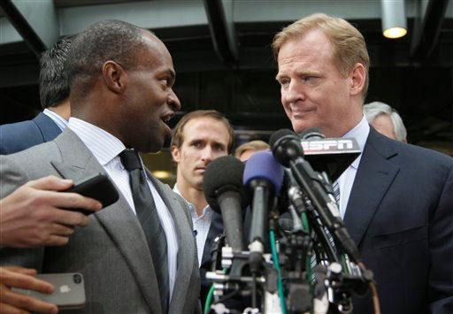 NFLPA Executive Director DeMaurice Smith, left, and NFL football Commissioner Roger Goodell take part in a news conference at the NFL Players Association in Washington, Monday, July 25, 2011.