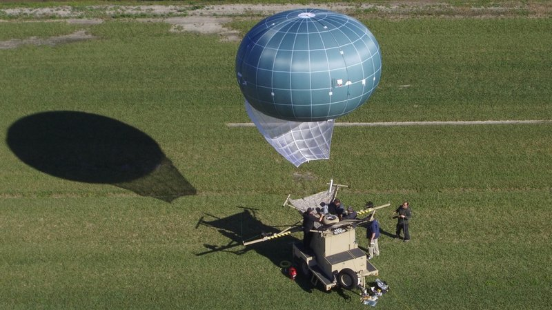 In this undated aerial photo provided by Drone Aviation Corp. shows a knock out tethered balloon, called Winch Aerostat Small Platform, or WASP.